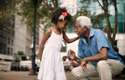 Granddaughter talking to grandfather