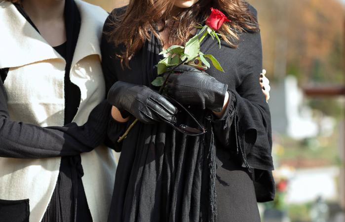 women at memorial service