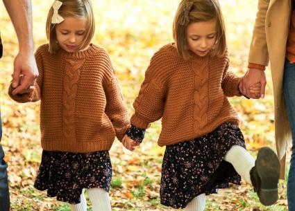 children walking in autumn woods