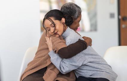 Supportive women hug