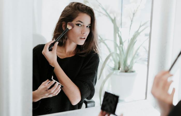woman applying Makeup for funeral