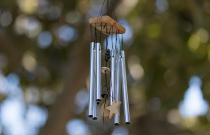 Wind chime hanging against trees
