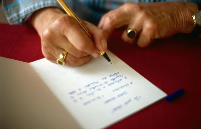Woman writing thank-you note