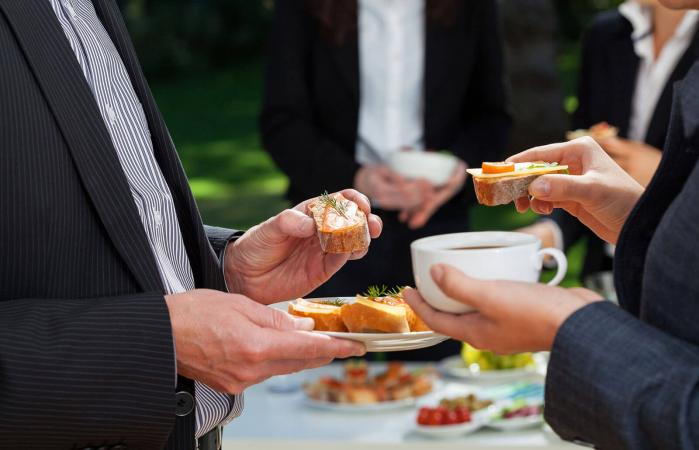 people eating finger food at a wake