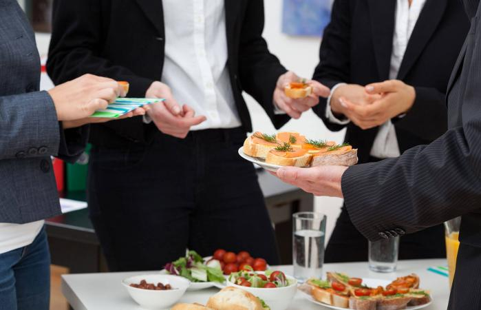group of people on funeral buffet