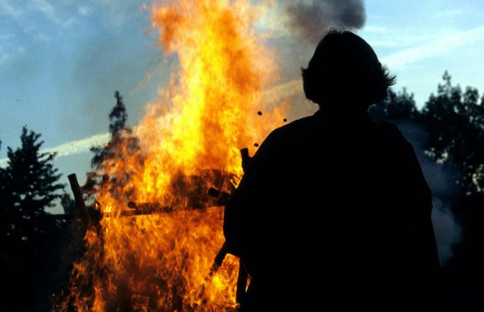 Man's silhouette at funeral pyre