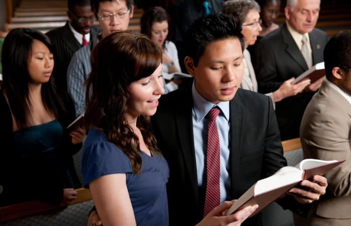 diverse church congregation worshipping together