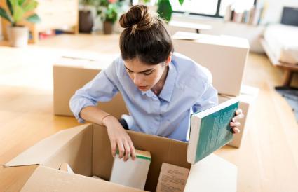woman packing cardboard box