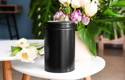 Mortuary urn on table in room