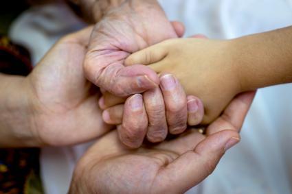 Three generations holding hands
