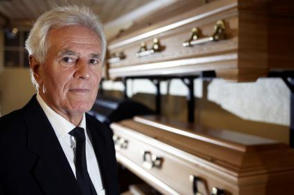 Funeral Director Standing in Funeral Parlour