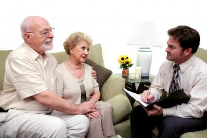 Senior couple speaking with a funeral director