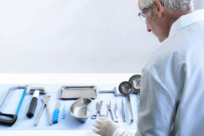 Pathologist preparing for autopsy