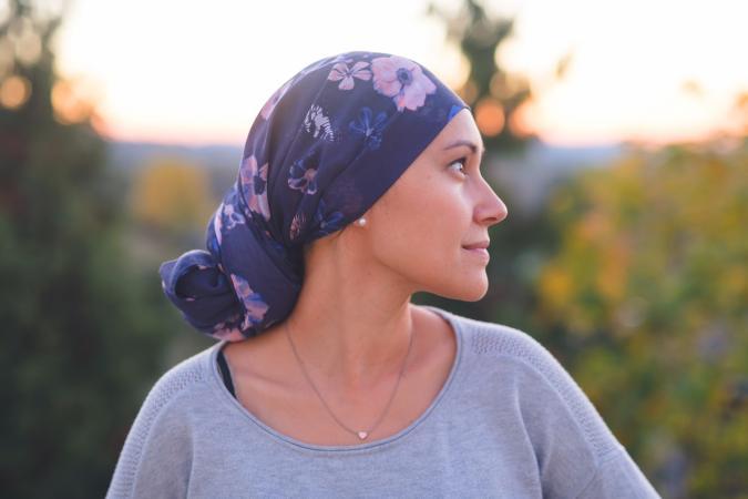 Woman wearing a head wrap smiling