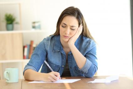 Sad woman writing letter