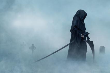 Grim reaper in a cemetery