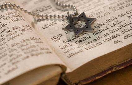 Star of David on book with Hebrew text