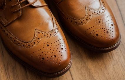 pair of brown derby shoes