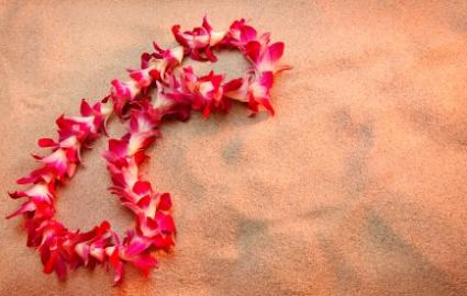 Lei left on the sand after a Hawaiian burial