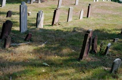 The first settlers in New England were buried in unmarked graves.