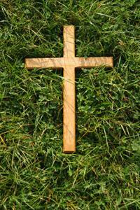 A wooden cross makes a simple and meaningful memorial for the loss of a beloved pet.