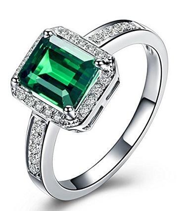 https://cf.ltkcdn.net/engagementrings/images/slide/186533-386x425-emerald-and-diamond-ring.jpg