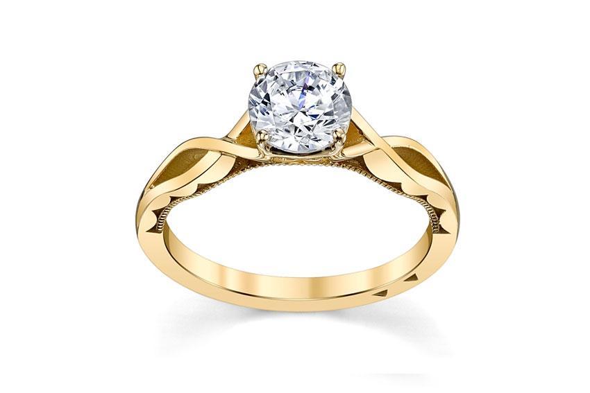 https://cf.ltkcdn.net/engagementrings/images/slide/190119-850x567-18K-Yellow-Gold-Engagement-Setting-by-Tacori.jpg