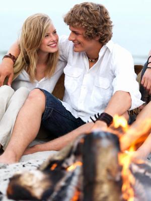Couple enjoying a romantic bonfire