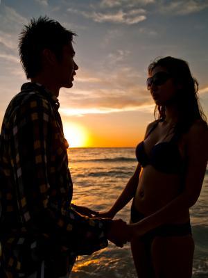 Romantic couple enjoying sunset at the beach