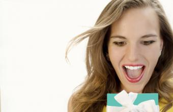 Excited woman holding a Tiffany gift box