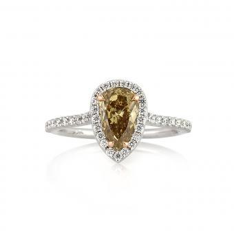 https://cf.ltkcdn.net/engagementrings/images/slide/205397-850x850-colored-diamond-pear.jpg