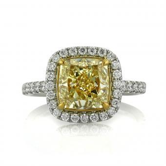 https://cf.ltkcdn.net/engagementrings/images/slide/205907-850x850-fancy-yellow-diamond-cushion.jpg