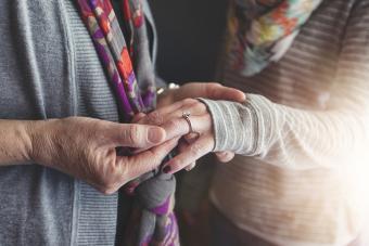 women admiring heirloom engagement ring
