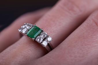 wide setting emerald and diamond ring