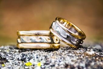 Pair of weathered wedding rings with a wave design