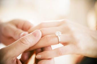 Man's and woman's hands with engagement ring