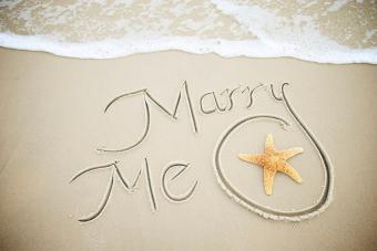 Marry Me Message Handwritten in Sand