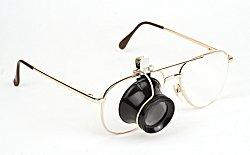 Glasses with a jeweler's loupe attached