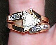 Split shank, trilliant diamond engagement ring