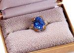 Deep blue diamond engagement ring in a box