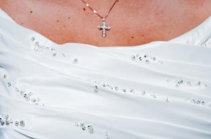 Wedding dress and cross necklace