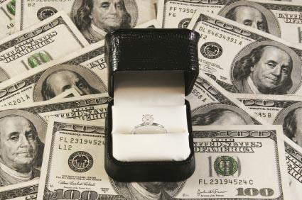Diamond ring on a pile of money