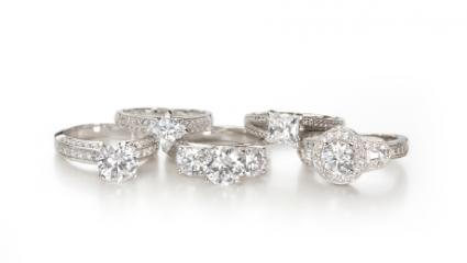 Five engagement rings with diamond chip accents