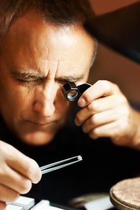 jeweler examining diamond