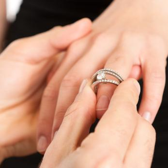 Putting a ring on her finger