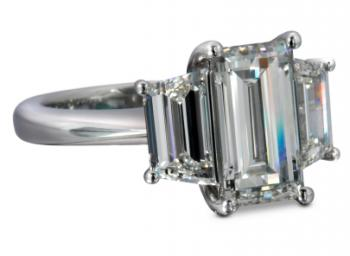 Emerald cut diamond engagement ring with matching trapezoid cut diamonds