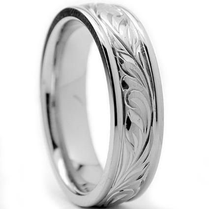 Silver-colored engraved band ring