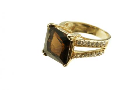 brown stone in gold setting