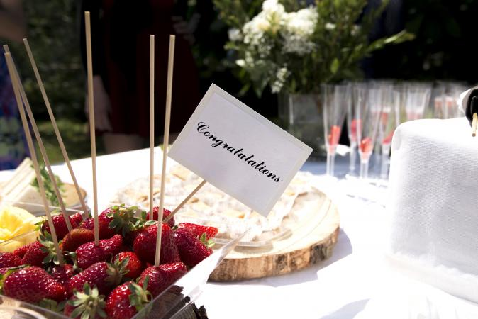 Outdoor engagement party table w/strawbetrries