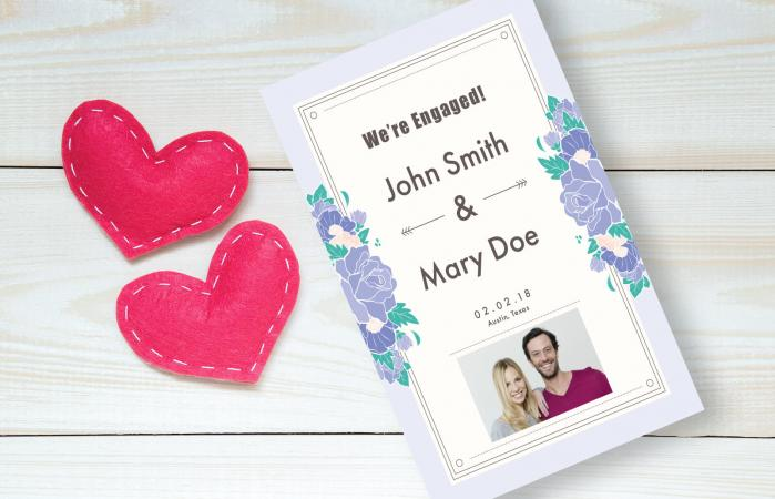 Engagement announcement on wooden table